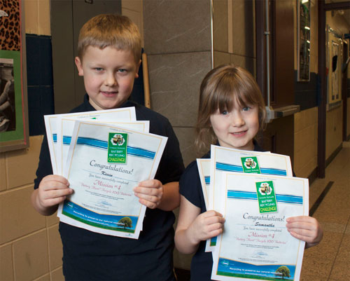 Kevin and Samantha receive battery recycling certificates for their environmental achievements!