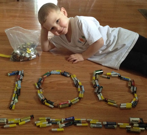 Clinton from Alma, Ontario poses with 100 batteries. Clinton is RMC's first ever Battery Boss!