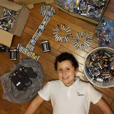 Antonio completed mission 4 and poses with all of the batteries he recycled during the Ontario Schools Battery Recycling Challenge.