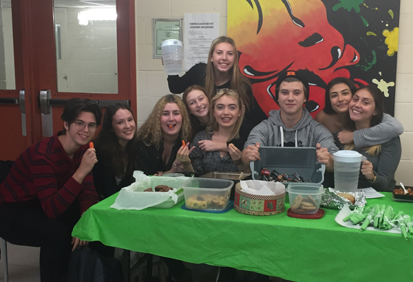 Harbord Collegiate Eco-team students host a bake sale to promote the schools battery recycling program as part of the Ontario Schools Battery Recycling Challenge