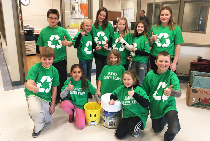 Students on the Jarvis Public School Green Team pose for a picture with their OSBRC battery recycling container.