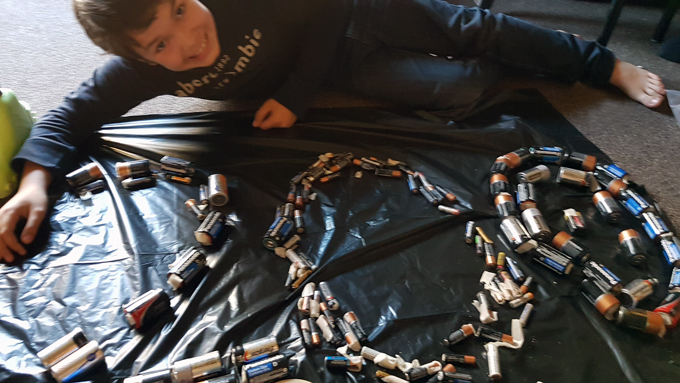 Liam was the first Battery Boss in the Ontario Schools Battery Recycling Challenge this year. In this image, he poses with 200 batteries that he recycled.